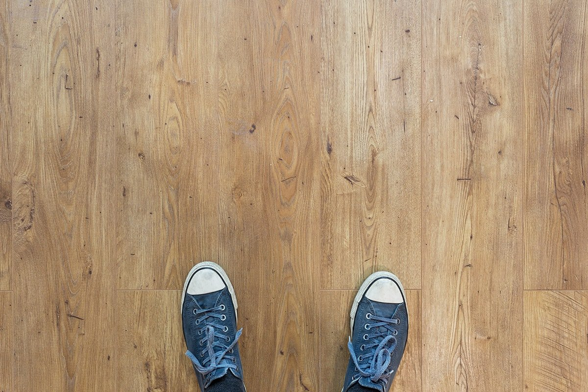 Standing on wooden floorboards