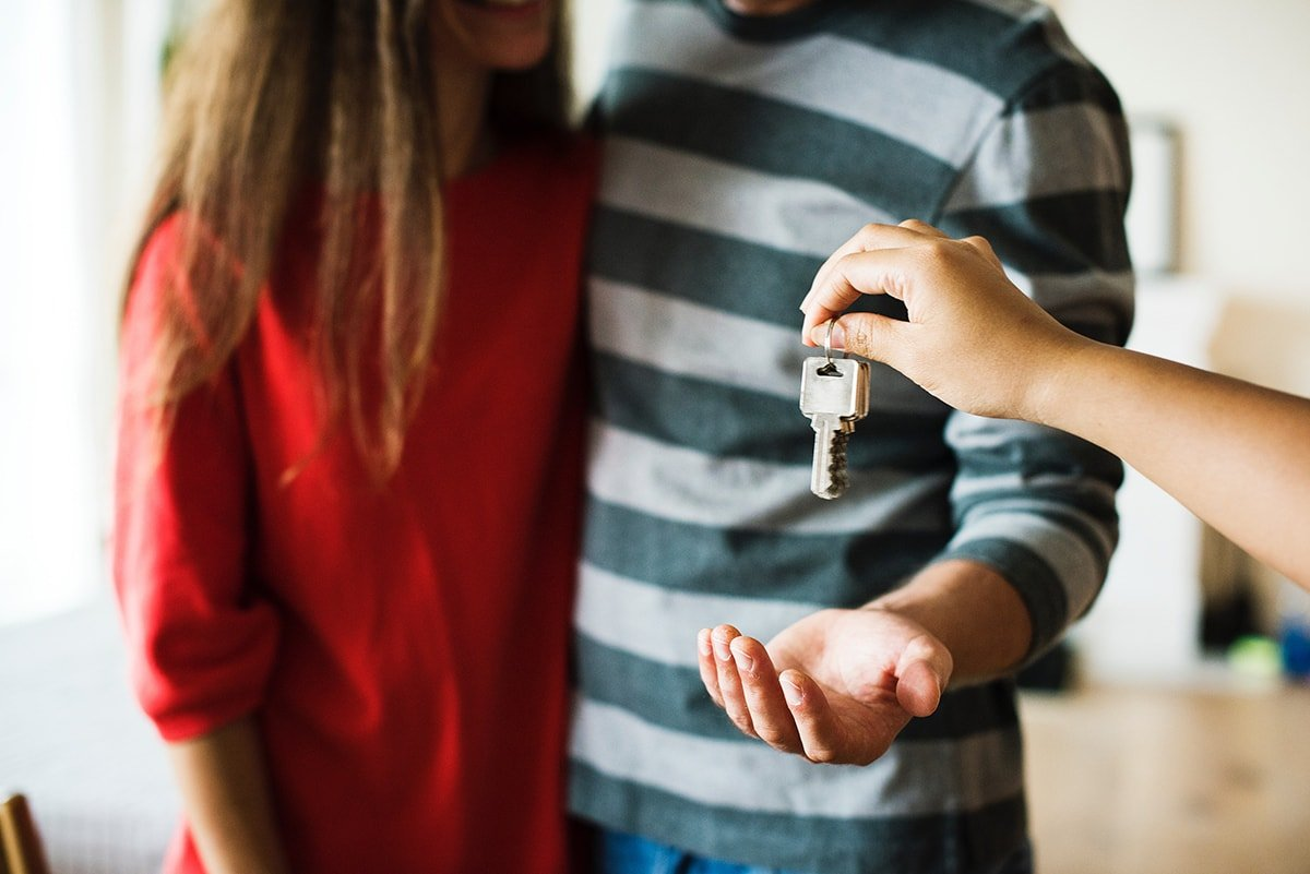 Couple receiving keys to new house