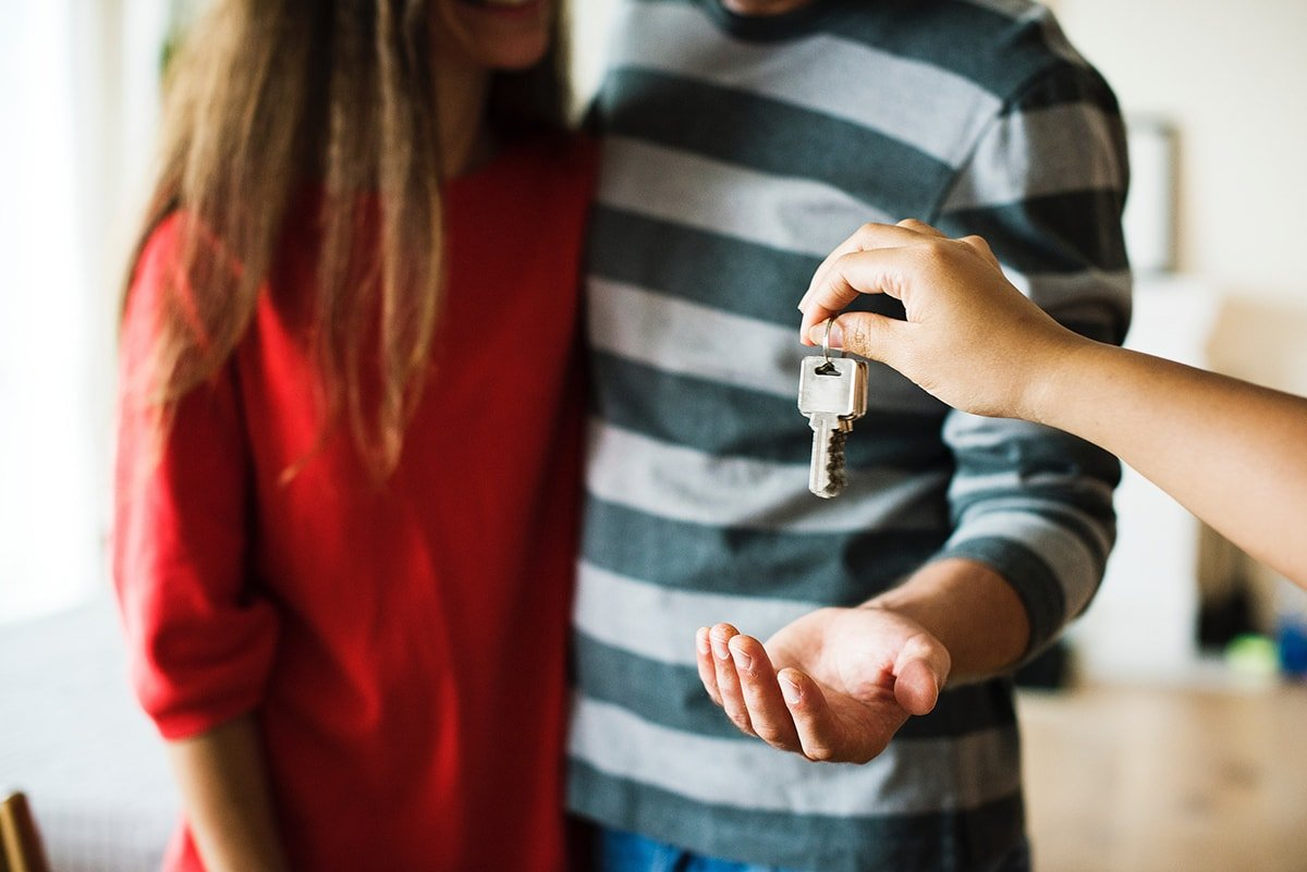 Giving keys to new home owners