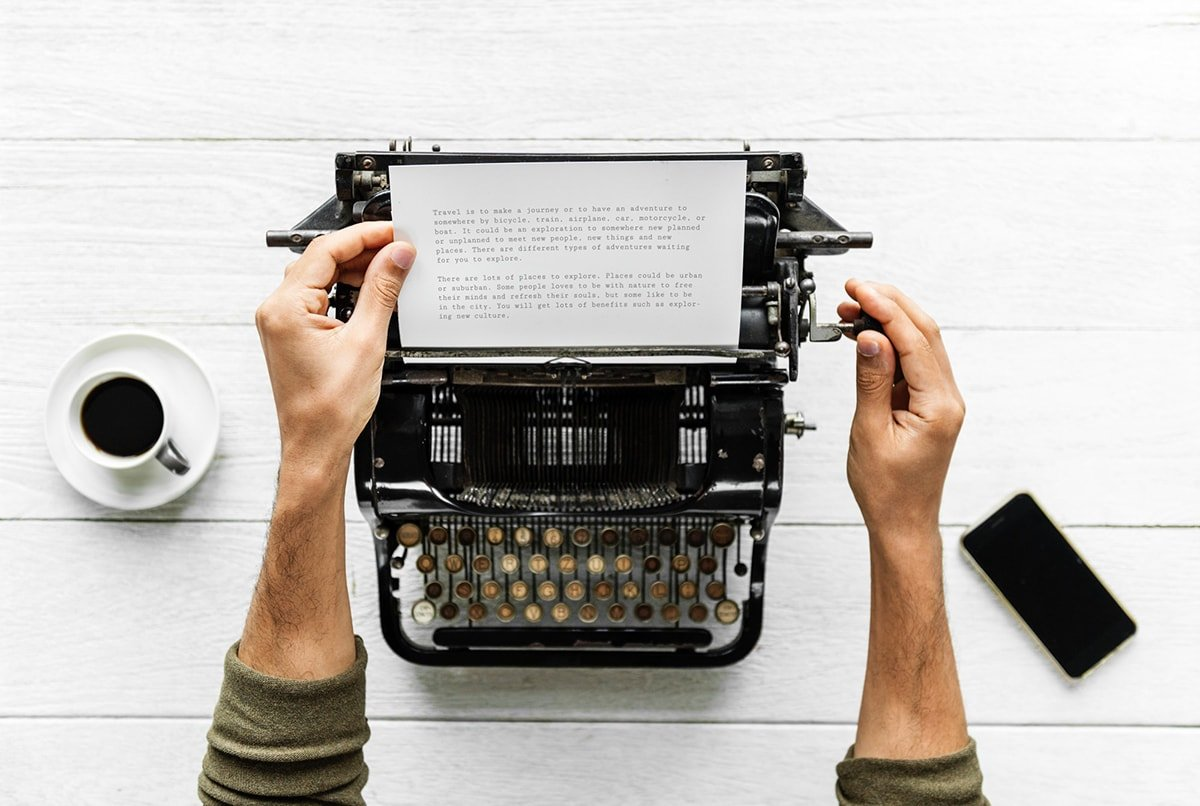 Person typing up a compelling story on a vintage typewriter