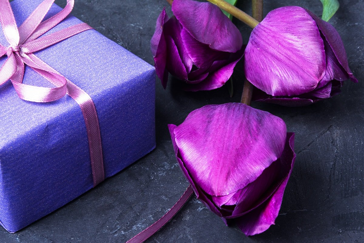 Purple gift with flowers