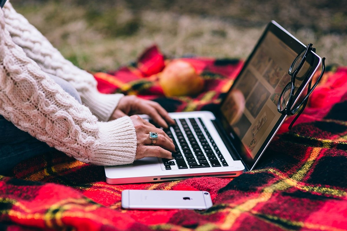 Person writing quality content on laptop